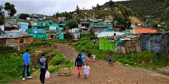 Casas de madera y latas son la vivienda de 240 mil personas en Bogotá