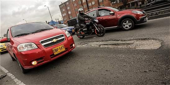 Los huecos de la Avenida Boyacá en Bogotá que ponen en riesgo la vida