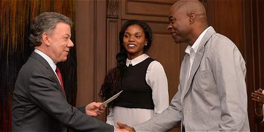 Juan Manuel Santos premió a Caterine Ibargüen y a su técnico