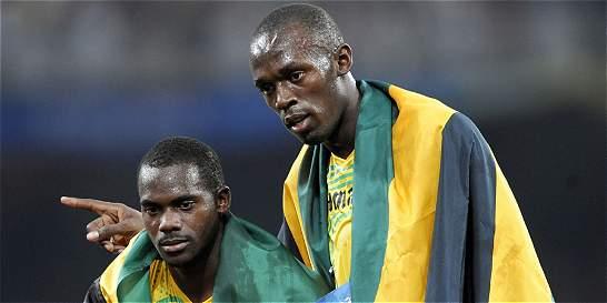 Usain Bolt devolvió la medalla retirada por positivo de Carter