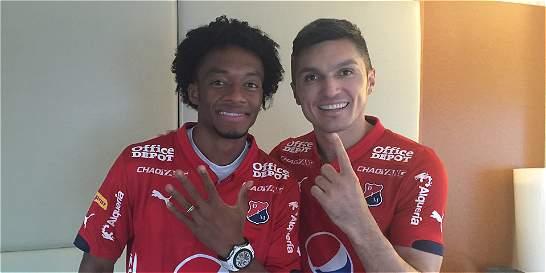 Cuadrado y Daniel Torres celebraron el título del DIM