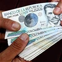 Salario mínimo quedó en 689.454 pesos; sindicatos estudian paro cívico