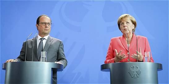 Merkel y Hollande urgen a Italia y Grecia abrir centro de inmigrantes