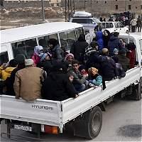 Alegría y miedo a bordo de los primeros autobuses hacia Alepo