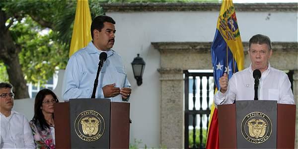 Los presidentes de Venezuela y Colombia al término de la cumbre realizada en Cartagena.
