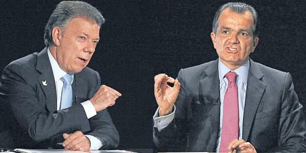 Candidatos a la presidencia Óscar Iván Zuluaga y Juan Manuel Santos.