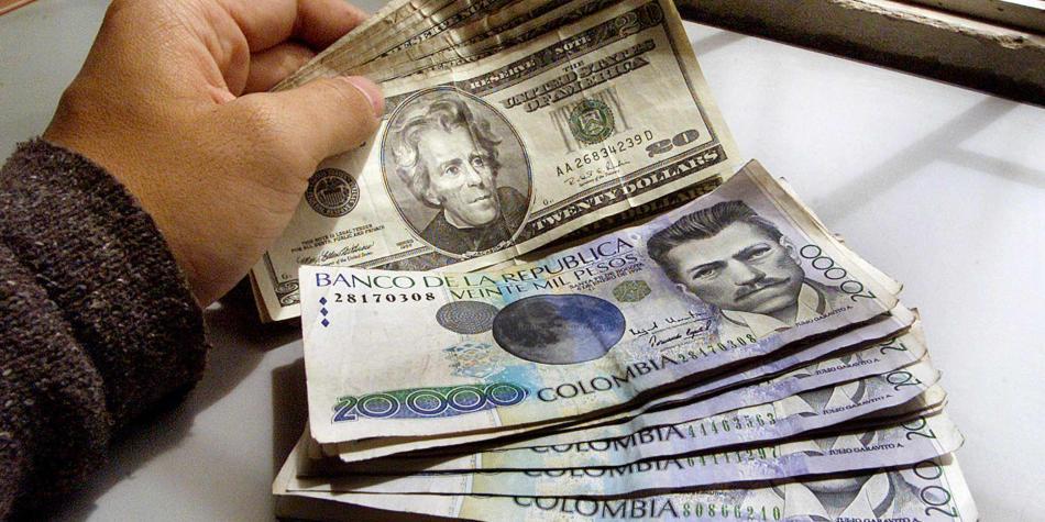 Dolar Y Peso Colombiano