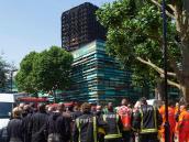 May pide perdón por reacción al incendio de edificio de Londres
